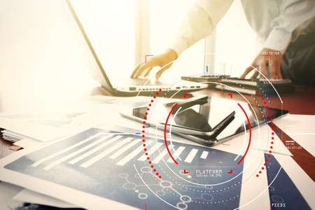 Foto de Concept of target focus digital diagram,graph interfaces,virtual UI screen,connections netwoork.Hipster finance analyst working with mobile phone and laptop at trendy office - Imagen libre de derechos