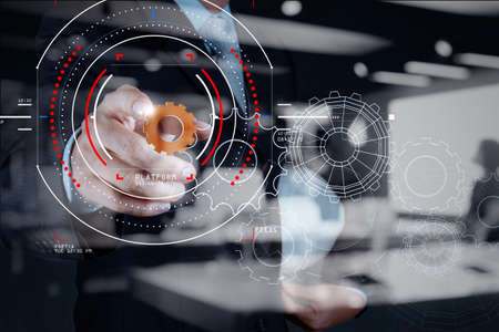 Foto de Concept of focus on target with digital diagram,graph interfaces,virtual UI screen,connections netwoork.Businessman showing gear or cog for sucess business. - Imagen libre de derechos