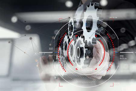 Foto de Concept of focus on target with digital diagram,graph interfaces,virtual UI screen,connections netwoork.Businessman showing gear or cog for sucess business. - Imagen libre de derechos