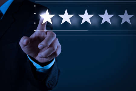 Foto de Five stars (5) rating with a businessman is touching virtual computer screen.For positive customer feedback and review with excellent performance. - Imagen libre de derechos