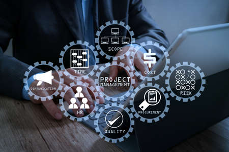 Foto de Project management diagram of cost, time, scope, human resources, risks, quality and communication with icons.success businessman hand working with digital tablet docking smart keyboard on wooden desk. - Imagen libre de derechos