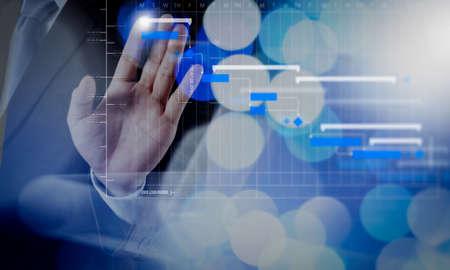 Foto de Project manager working and update tasks with milestones progress planning and Gantt chart scheduling diagram.businessman working with digital cloud network concept. - Imagen libre de derechos