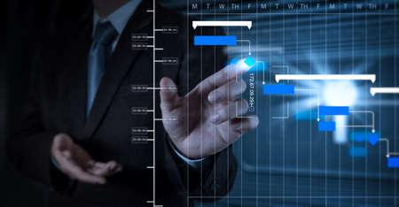 Foto de Project manager working and update tasks with milestones progress planning and Gantt chart scheduling diagram.businessman hand working with touch screen in action - Imagen libre de derechos