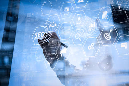 Foto de Seo Optimization for website with mobile website and Landing page virtual diagram.businessman hand working with modern technology and digital layer effect as business strategy concept - Imagen libre de derechos