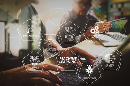 Foto de Machine learning technology diagram with artificial intelligence (AI),neural network,automation,data mining in VR screen.Coworking process, entrepreneur team working in creative office space using digital tablet. - Imagen libre de derechos