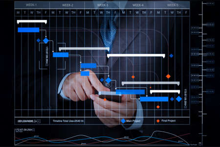 Foto de Project manager working and update tasks with milestones progress planning and Gantt chart scheduling virtual diagram.businessman hand using mobile smart phone. - Imagen libre de derechos