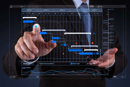 Foto de Project manager working and update tasks with milestones progress planning and Gantt chart scheduling virtual diagram.businessman hand  working with touch screen in action. - Imagen libre de derechos
