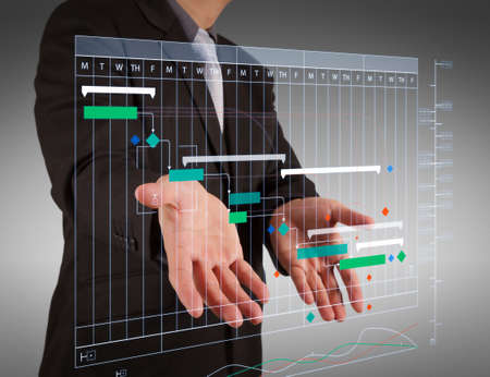 Foto de Project manager working and update tasks with milestones progress planning and Gantt chart scheduling virtual diagram.business man with an open hand as showing something concept. - Imagen libre de derechos