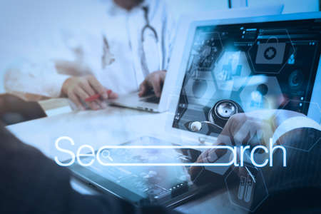 Photo for Searching Browsing Internet Data Information Networking Concept with blank search bar.medical doctor hand working with smart phone,digital tablet computer,stethoscope eyeglass on wooden desk. - Royalty Free Image