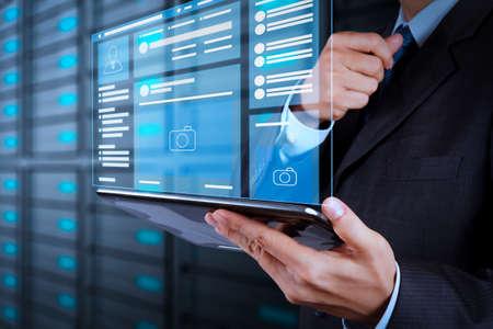 Foto de Web page browser of Social media Page VR Interface on the laptop computer.businessman hand using tablet computer and server room background - Imagen libre de derechos