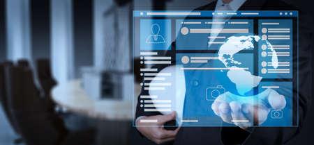 Foto de Web page browser of Social media Page VR Interface on the laptop computer.engineer businessman hand shows the earth as construction concept - Imagen libre de derechos