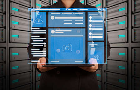 Foto de Web page browser of Social media Page VR Interface on the laptop computer.tablet computer in a hands on server room - Imagen libre de derechos