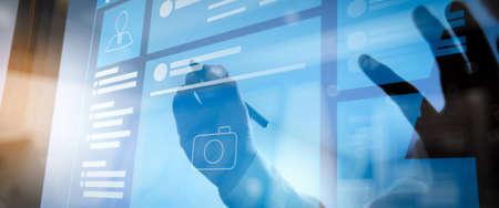 Foto de Web page browser of Social media Page VR Interface on the laptop computer.Businessman hand pressing an imaginary button on virtual screen - Imagen libre de derechos