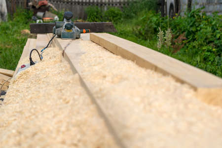 Photo pour electric woodworking tools lying on the lumber outdoors - image libre de droit