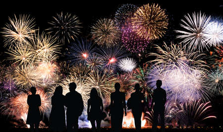 Photo pour Group of people looks beautiful colorful holiday fireworks, long exposure - image libre de droit