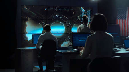 Foto de Back view of people working and managing flight in mission control center. Landing of spaceship on Moon. - Imagen libre de derechos