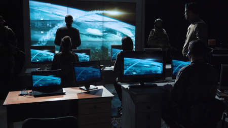 Foto de Authority man giving order to launch nuclear bomb and tracking it on digital screen. - Imagen libre de derechos