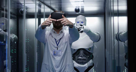 Photo for Medium shot of an engineer testing on robot controls using vr headset - Royalty Free Image