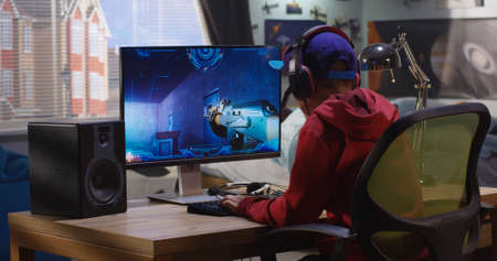 Photo for Medium shot of a boy playing with a first-person shooter video game - Royalty Free Image