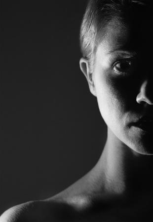 half of the  face of girl in the dark, monochrome