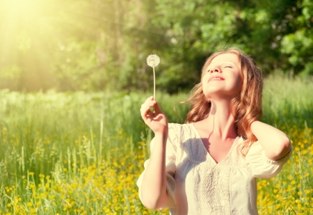 Photo for beautiful girl with dandelion enjoying the summer sun  - Royalty Free Image