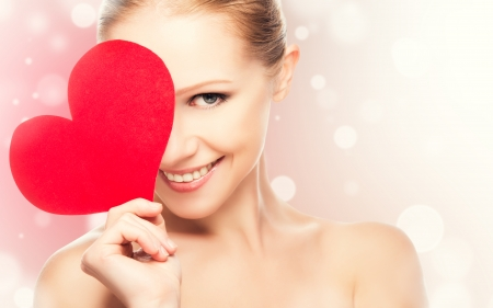 Photo pour face of a beautiful young woman with red heart symbol of love - image libre de droit