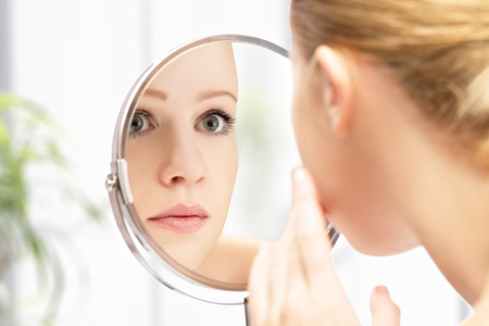Photo for face of young beautiful healthy woman and reflection in the mirror - Royalty Free Image
