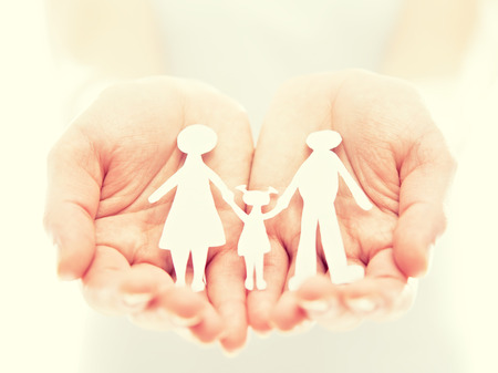 Photo for concept. paper figures of family in the hands  - Royalty Free Image