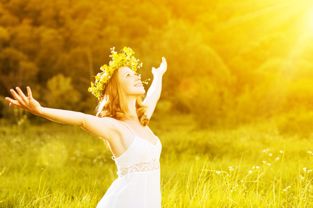 Photo pour happy woman in wreath outdoors summer enjoying life opening hands  - image libre de droit