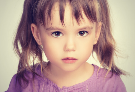 Photo for face of a little beautiful girl with sad eyes - Royalty Free Image
