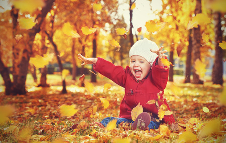 Photo pour happy little child, baby girl laughing and playing in the autumn on the nature walk outdoors - image libre de droit