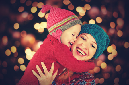 Photo for happy family mother and baby little daughter playing in the winter for the Christmas holidays - Royalty Free Image