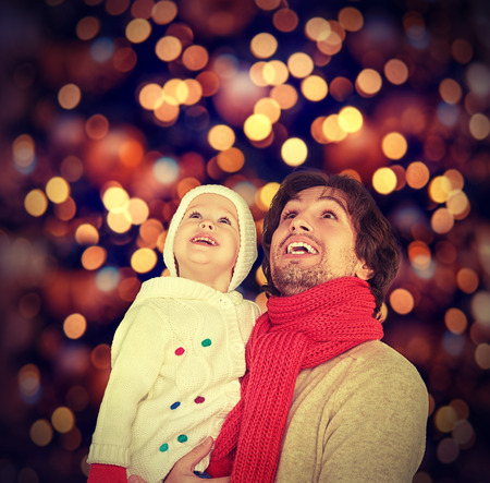 Foto de happy family father and child baby daughter and a Christmas miracle - Imagen libre de derechos