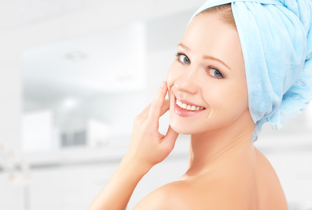 Photo pour skin care. young beautiful healthy girl in a towel in the bathroom - image libre de droit