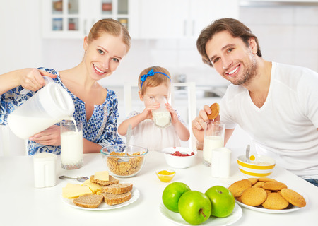 Photo for Happy family mother, father, child baby daughter having breakfast at home - Royalty Free Image