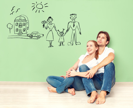 Foto de concept. young happy family couple dreaming of new house, car, child, financial well-being - Imagen libre de derechos