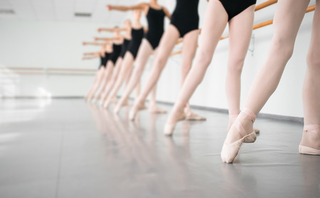 Photo pour legs of young dancers ballerinas in class classical dance, ballet - image libre de droit