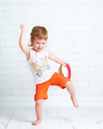 Photo for happy beautiful baby girl dancer dancing modern hip hop dance - Royalty Free Image