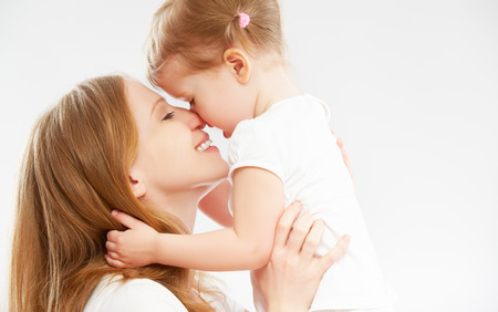 Photo pour happy family mother and child baby daughter hugging and kissing - image libre de droit
