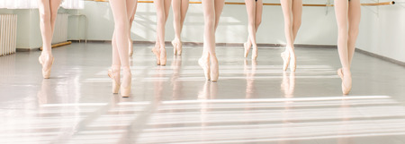 Photo for legs of young dancers ballerinas in class classical dance, ballet - Royalty Free Image