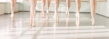 Photo pour legs of young dancers ballerinas in class classical dance, ballet - image libre de droit