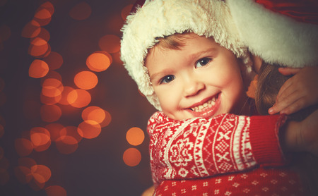 Foto de Christmas magic  a woman happy family mother and Child - Imagen libre de derechos