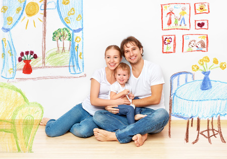 Photo pour Concept family: Happy young family in the new apartment dream and plan interior - image libre de droit