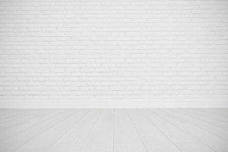 Foto de white blank brick wall and wooden floor in an empty room - Imagen libre de derechos