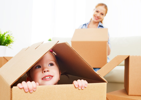 Photo for happy family moves into a new apartment. happy baby in a cardboard box - Royalty Free Image