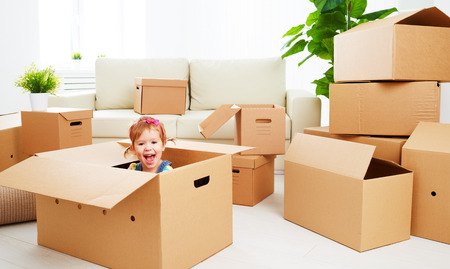 Photo for moving to a new apartment. happy child in a cardboard box - Royalty Free Image