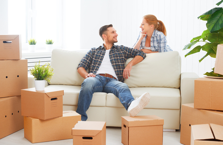 Photo for moving to a new apartment. Happy family couple and a lot of cardboard boxes. - Royalty Free Image