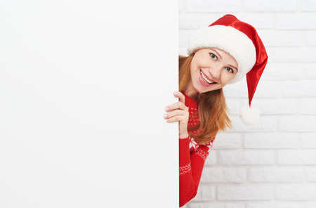 Photo pour happy woman at Christmas with an blank empty white poster - image libre de droit