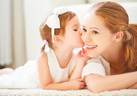 Photo pour happy family.  Little child girl kisses her mom - image libre de droit