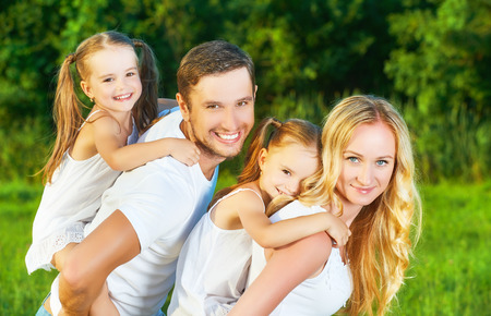 Photo pour happy family on the nature of the summer, mother, father and children twin sisters - image libre de droit